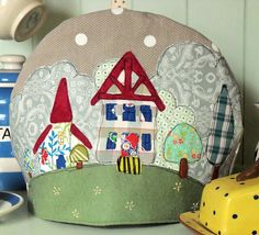 Country Village Tea Cosy  ..  New free pattern from Bustle & Sew - accompanied by a video tutorial to help get to grips with freestyle machine embroidery