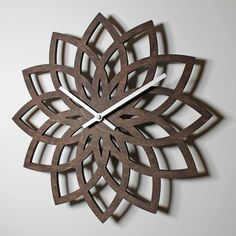 "Lotus wall clock. Laser cut Birch plywood. 12"" diameter."