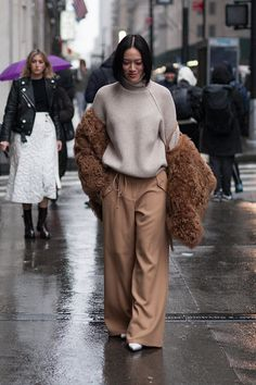Tiffany Hsu is seen attending Victoria Beckham during New York Fashion Week wearing a brown fringe coat with cream sweater and tan pants on February...
