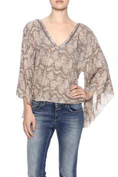 fdbf83c6c9d Balisani top has a v-neck with embellishments and long bell sleeves. -  Hurricane