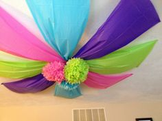 Plastic table clothes and paper flowers in ceiling