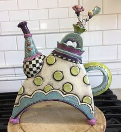 Handmade hand built clay ceramic slab pottery whimsical teapot with polkadots, checkerboard and lots of hand carved design. Flowered lid and multicolor glazes.