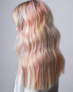 Add some color to your life with pastel highlights. Let's be honest, us unicorn lovers can't resist an opportunity to get in touch with our magical side. #unicornhair #pastelhighlights #haircolor #hairtrends #fallhair