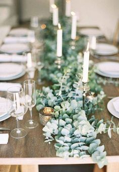 Lay strands of eucalyptus leaves along the length of the table for a fragrantly chic and easy centerpiece. Filter in candleholders and candle sticks to complete the look. Wedding Table Decorations, Wedding Table Settings, Wedding Centerpieces, Centerpiece Ideas, Table Wedding, Wedding Ceremony, Table Centerpieces, Wedding Table Runners, Square Wedding Tables