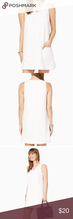 Skipper Shift Dress A lace-up V-front takes this straight shift dress to new heights, while front patch pockets and a relaxed fit give it a casual spin. Pair with a neutral wedge for a look that's undeniably chic. Dresses Midi