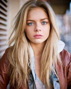 A Girl With Blonde Hair Blue Eyes