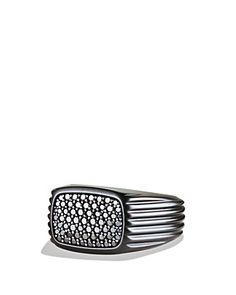 This black titanium sterling ring with silver and black diamonds is everything to a must have in the complete package look. Gives the guy a persona and shows off that he can really dress himself.