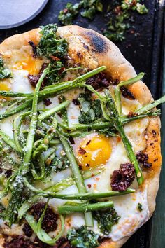 Springtime pizza with chipotle romesco, eggs and shaved asparagus salad