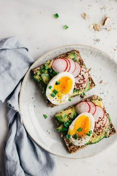 The healthiest spring sandwich, with avocado, egg, radishes and scallions on top of super-seed bread   http://TheAwesomeGreen.com