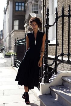 Yasmin Sewel in black sleeveless dress with surfboard necklace and Acne heels, photo by Garance Dore