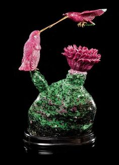 A Ruby, Zoisite and Gold Hummingbirds Carving,, , attributed to Luis Alberto Quispe Aparicio, the realistic sculpture consisting - Price Estimate: $2000 - $3000