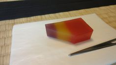 "Traditional Japanese Sweets ""Yokan (a thick jellied dessert made of red bean paste)"" which made by Toraya. This yokan is called ""Chitose-Giku (a thousand year chrysanthemum)"".  The three colors represent those of chrysanthemums."