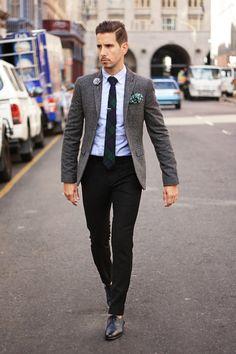 Grey flannel blazer, blue oxford shirt, grey lapel flower. green and white polka dot pocket square, Green navy and black tartan tie, black woolen pants, blue and black brogues