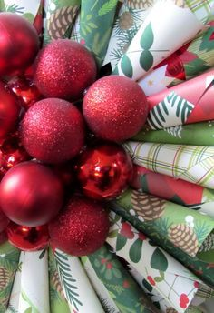 This Christmas Wreath makes a Holiday  statement!  DIY Paper Cone Wreath and red dollar store ornaments in the middle.