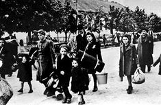 Jews from the Prague Ghetto being deported to Theresienstadt