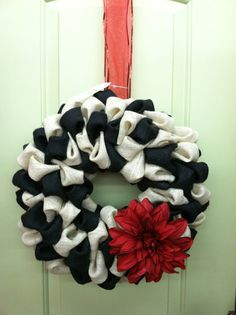 Black and White Burlap Wreath. Maybe a more tasteful flower but I love the black and white.