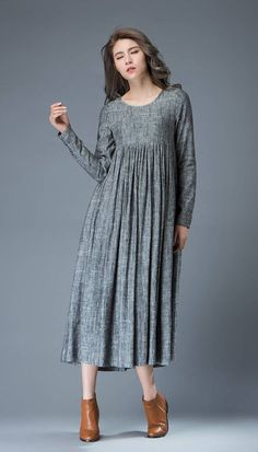 The Linen dress is made of linen blend. The gray linen dress is a oversized dress. the woman dress has no zipper and buttons. Super feminine and comfortable, this casual marl gray linen dress is a must-have for any spring/summer wardrobe. Wear it with a pure silk stole to give it a classy