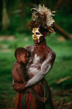 Arambak Tribesman and Child at a Papua New Guinea Sing-Sing, 2000 - Photograph by Bob Krist - An Arambak tribesman pauses for a family moment before joining a sing-sing near his home along the Karawari River, a tributary of the Sepik.