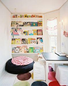 Book nook: Corner, Table,  beanbag chair(s).