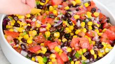 Black Bean and Corn Salsa is such a perfectly festive chunky salsa that loads up your chip with a dip that makes your mouth dance! Done in minutes, you can go from prep to attack in about Corn Tomato Salad, Tomato Salsa Recipe, Fresh Tomato Recipes, Fresh Tomato Salsa, Cucumber Recipes, Canned Salsa Recipes, Bean Dip Recipes, Black Bean Corn Salsa, Salsa With Corn