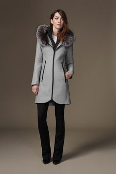 CHARLENE-F6X is a timeless, slim fit, mid-length coat made from luxurious diagonal wool. A removable inside bib and collar provide extra warmth and multi-season use. Features a removable fur trim on the face-framing hood, along with leather trim and stretch lining for extra comfort. Discover at http://www.soiakyo.com/ca/en/charlene-f6x-slim-fit-wool-coat-with-fur-trim-in-ash-for-women