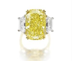Fancy intense yellow diamond ring. Via Southeby's.
