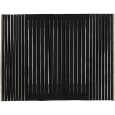 Shop black with white stripe rug.   Field of black backgrounds a modern linear weave.  Thin white lines stripe a graphic pattern in a soft wool/cotton blend.  Flatweave is comfortable underfoot yet stands up to traffic.
