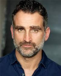 John Marquez.  PC Penhale in ITV's Doc Martin.  -- Love the stubble!