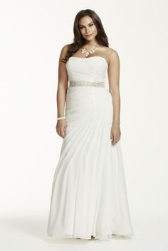 Stunningly simple and elegant, this crinkle chiffon wedding dress is a true classic!  Strapless crinkle chiffon gown features figure flattering soft asymmetrical draping.  Sweep train.