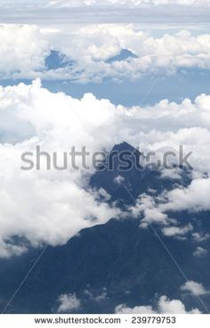 White clouds in blue sky and mountain - stock photo