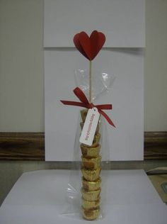 Took 10 mini Reese cups and speared them with a bamboo skewer. Wrapped them in a pretzel-size bag, tied with ribbon, added tag and 3-dimensional heart. Makes a great teacher's gift!
