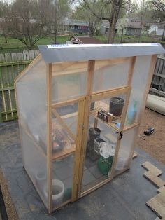 Homemade Greenhouse - I wonder if I could make it 3 sided to sit agains the house and be foldable for summer storage...hmm....