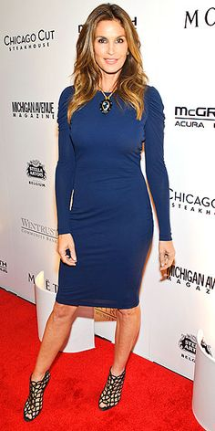 CINDY CRAWFORD The supermodel shows off her curves in a figure-hugging blue dress with ruched sleeves and caged heels at the Michigan Avenue Magazine party in Chicago.
