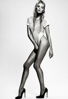 Implied, legs, model, black and white, stilettos, love the ease in the pose and her expression.