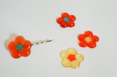 Melt some pony beads to create colorful accessories or scrapbook embellishments