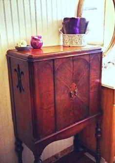 Antique Radio Cabinet Repurposed As Storage In My Bathroom.