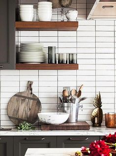 Subway tiles and vintage accent pieces make for a very stylish kitchen. More from Inside Our Mini-Makeover of Bon Appetits Kitchen here!
