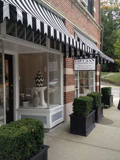 Red brick, black and white awnings