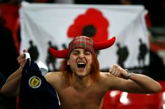England Scotland go through with poppy tribute   London (AFP)  England captain Wayne Rooney and Scotland counterpart Darren Fletcher led out teams sporting black armbands with red poppy motifs for Fridays World Cup qualifier paying a commemorative war dead tribute at Wembley that leaves both nations at risk of FIFA sanctions.  Footballs world governing body has warned the move could contravene rules banning political religious or personal slogans statements or images.  But the two countries…