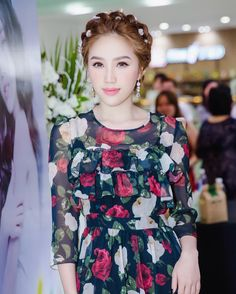 """Singer Bảo Thy Trần in a rose print long chiffon dress from the Blugirl Fall Winter 2016/17 Fashion Show Collection while attending the """"I love you"""" video premiere. • Saigon, Vietnam – October, 14 2016"""