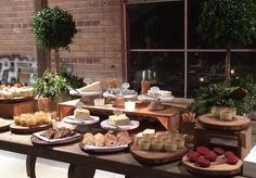 Rustic Display of cheese and dessert station at catered event