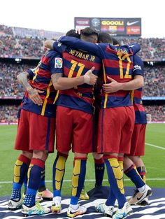 Barcelona's Brazilian forward Neymar (C) is congratulated by his teammates after scoring during the Spanish league football match FC Barcelona vs RCD Espanyol at the Camp Nou stadium in Barcelona on May 8, 2016.
