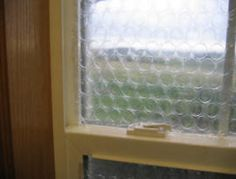 This is a simple technique for insulating windows with bubble wrap packing material.  Bubble wrap is often used to insulate greenhouse windows in the winter, but it also seems to work fine for windows in the house.   You can use it with or without regular or insulating window shades.  It also works for windows of irregular shape, which can be difficult to find insulating shades for.
