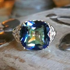 Mystic Rainbow Topaz ring Gorgeous big square shaped mystic topaz stone beautifully set in an ornate 925 silver setting Jewelry Rings Bangle Bracelets, Bangles, Necklaces, Handmade Silver, Handmade Jewelry, Rainbow Topaz, Copper Rose, Mystic Topaz, Topaz Ring