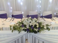 white and purple wedding tables | ... just had small sprays of purple lisianthus in the corner of each tier