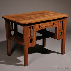 Arts & Crafts Desk  Oak  United States, early 20th century  Rectangular top over single drawer flanked by pierced splats, openwork sides for books, ht. 29 1/2, wd. 41 3/4, dp. 27 1/2 in.  Estimate $250-350