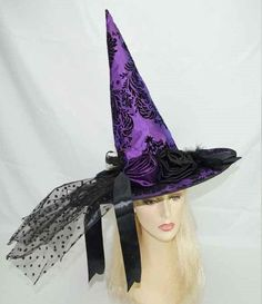 One size fits most adult witch's hat decorated in purple fabric with black felt damask designs, feathers, silk ribbon flowers, and polka dot tulle. Perfect for witching hour. Also available in stores                                                                                                                                                                                  More