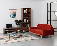 Looking for a velvet sofa that suits a modern living room? This burnt orange sofa creates a striking focal point. Tiny Living Rooms, Small Living Room Design, Living Room Storage, Living Room Modern, Living Room Designs, Wicker Dining Chairs, Living Room Chairs, Lounge Chairs, Sofa Design