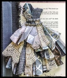 Original pinners excellent first paper dress.added antique lace, old book page, vintage necklace trim, vintage ribbon and gray burlap.in a shadowbox frame.my favorite:this paper dress is soooo awesome! Gold Chain With Diamond PendantsImpressive -> Si Dress Card, Ideias Diy, Old Book Pages, Antique Lace, Mixed Media Canvas, Mixed Media Artwork, Little Dresses, Fabric Art, Altered Art