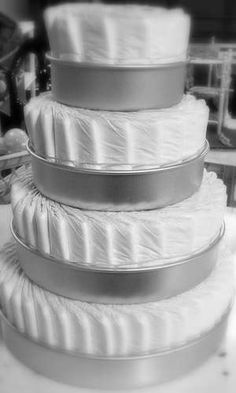 cake pans to help diaper cake, then put the ribbons around, etc